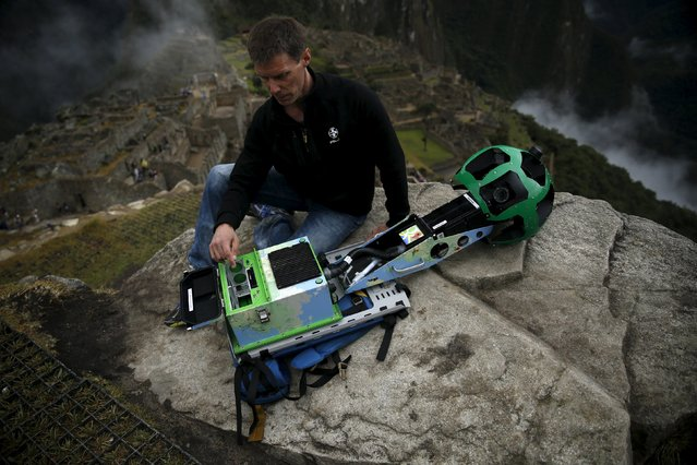 Daniel Filip, Tech Lead Manager for Google Maps, shows parts of the Trekker, a 15-camera device, while mapping the Inca citadel of Machu Picchu for Google Street View in Cuzco, Peru, August 11, 2015. (Photo by Pilar Olivares/Reuters)