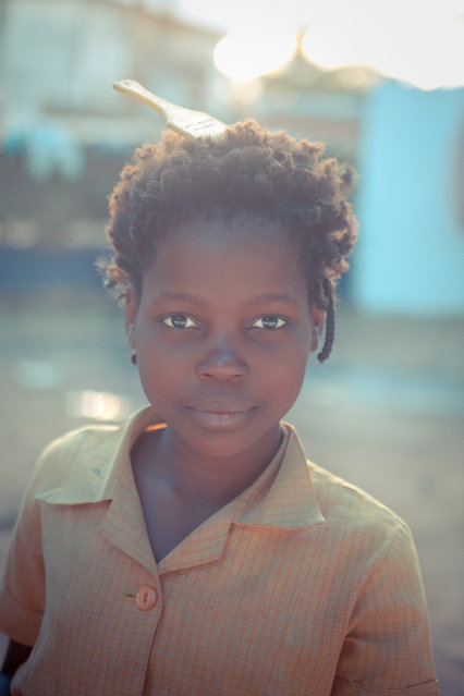 """Local girl"". A local girl with a comb in her hair, Chimoio, central Mozambique close to the border with Zimbabwe... (Photo and caption by Nicholas Zajicek/National Geographic Traveler Photo Contest)"