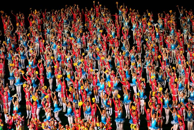 """North Korean children perform during the """"Arirang"""" mass games in Pyongyang, on July 22, 2013. (Photo by Wong Maye-E/Associated Press)"""
