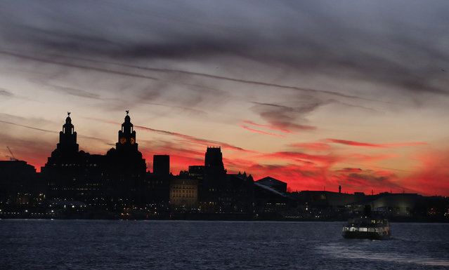 A ferry crosses the river Mersey during sunrise in Liverpool, northern England January 20, 2015. (Photo by Phil Noble/Reuters)