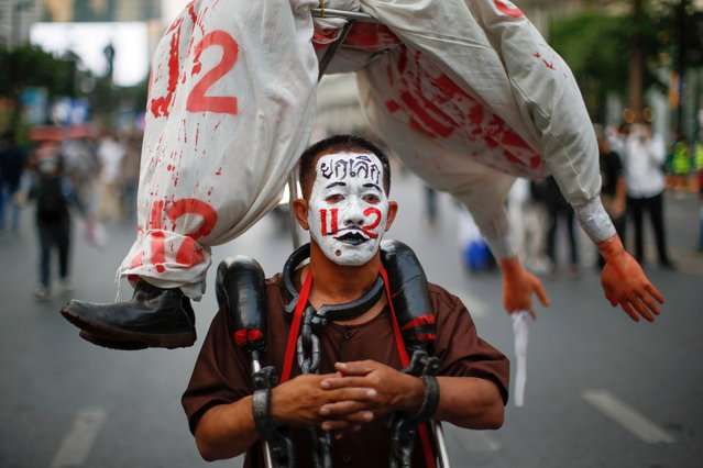 A pro-democracy protester with a painted face participates in a rally demanding the release of arrested protest leaders and the abolition of 112 lese majeste law, in Bangkok, Thailand, March 24, 2021. (Photo by Jorge Silva/Reuters)
