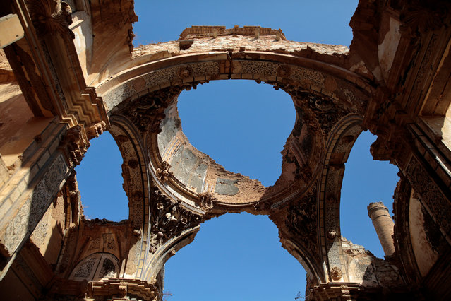 Sky is seen through the holes of the San Agustin church ceiling in the old village of Belchite, in northern Spain, October 3, 2016. (Photo by Andrea Comas/Reuters)