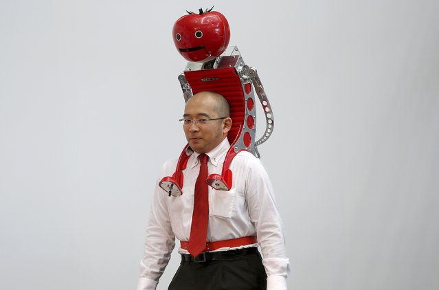 "Kagome Co's employee Shigenori Suzuki appears with the newly-developed ""Wearable Tomato"" device for runners during its unveiling event ahead of the weekend's Tokyo Marathon in Tokyo February 19, 2015. (Photo by Toru Hanai/Reuters)"