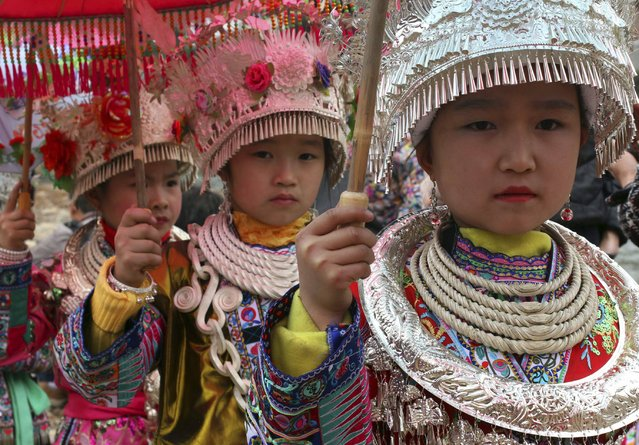 Ethnic Miao children wearing traditional costumes perform during Chinese New Year celebrations in Rongshui, Guangxi Zhuang Autonomous region, February 21, 2015. (Photo by Reuters/Stringer)