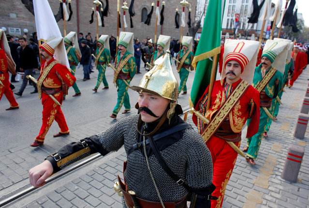 Turkish soldiers in historical Ottoman janissary outfits, march during a ceremony, one of many marking the 743rd anniversary of the death of Mevlana Jalaluddin Rumi, in Konya, Turkey, December 7, 2016. (Photo by Murad Sezer/Reuters)