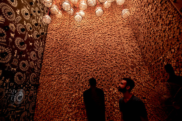 Indian artists work on a makeshift pandal made with wood, fiber, metal and bamboo by artist Anirban Das in Kolkata, Eastern India, 23 September 2018. Bengalis all over the world will be marking the festival representing the victory of good over evil and the celebration of female power from 15 to 19 th October 2018. (Photo by Piyal Adhikary/EPA/EFE)