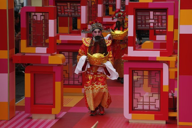 Performers dressed as Cai Shen or God of Wealth, take part in a Chinese New Year celebration at a shopping mall in Hong Kong February 23, 2015. (Photo by Bobby Yip/Reuters)
