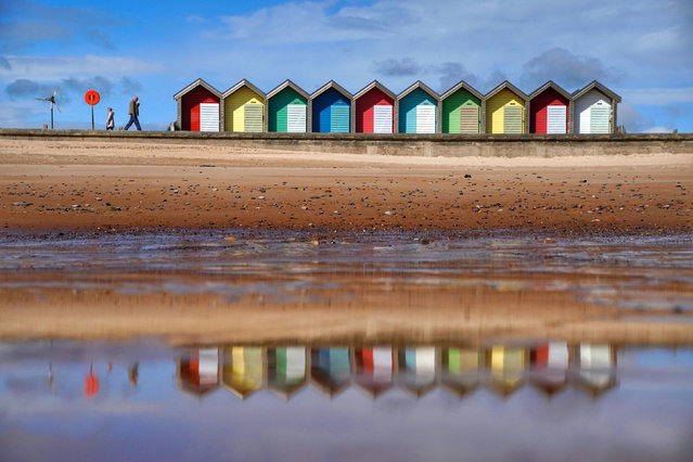 People walk along the sea front at Blyth in Northumberland in North East England on Monday, May 24, 2021. (Photo by Owen Humphreys/PA Images via Getty Images)