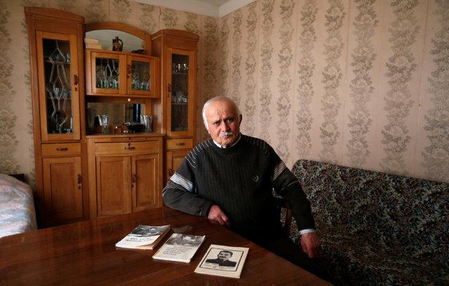 "Retired builder Shalva Didebashvili, 78, poses for a portrait at his home in Mtskheta, Georgia, November 29, 2016. ""What Jesus Christ is for many religious people, Stalin is the same for me"", Didebashvili said. (Photo by David Mdzinarishvili/Reuters)"