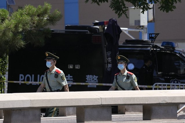 Chinese paramilitary policemen patrol the streets leading to Tiananmen Square area on the 32nd anniversary of a deadly crackdown on pro-democracy protests in Beijing on Friday, June 4, 2021. Commemorations of the June 4, 1989, crackdown on student-led pro-democracy protests centered on Beijing's Tiananmen Square were especially muted Friday amid pandemic control restrictions and increasing political repression. (Photo by Ng Han Guan/AP Photo)