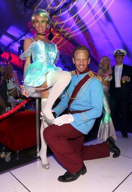 Actor Ian Ziering (R) and Erin Kristine Ludwig attend Playboy Mansion's annual Halloween bash on October 26, 2013 in Holmby Hills, California. (Photo by Christopher Polk/Getty Images for Playboy)