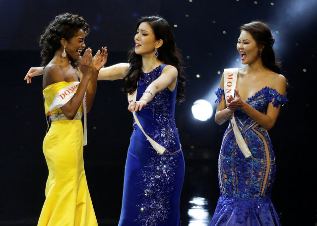 Miss Dominican Republic Yaritza Miguelina Reyes Ramirez (L) is congratulated by Miss Korea Hyun Wang and Miss Mongolia Bayartsetseg Altangerel after she was named a finalist in the Miss World 2016 Competition in Oxen Hill, Maryland, U.S., December 18, 2016. (Photo by Joshua Roberts/Reuters)