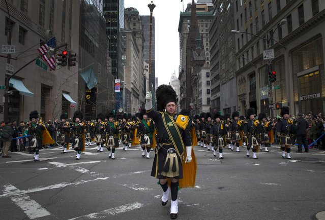 The New York City Police Emerald Society pipe and Drum Corps marches in the 254th New York City St. Patrick's Day parade up 5th Avenue in the Manhattan Borough of New York, March 17, 2015. (Photo by Mike Segar/Reuters)