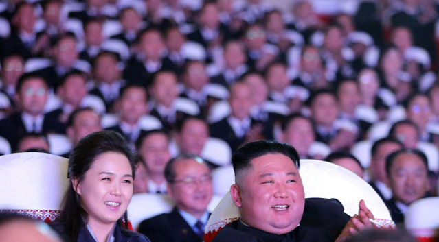 This picture taken on February 16, 2021 released from North Korea's official Korean Central News Agency (KCNA) on February 17 shows North Korean leader Kim Jong Un and his wife Ri Sol Ju watching a performance for celebrating the birth anniversary of Chairman Kim Jong Il at the Mansudae Art Theatre in Pyongyang. (Photo by KCNA via Reuters)