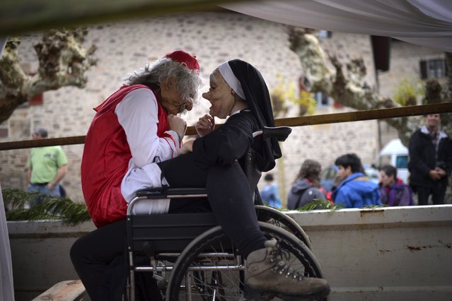 Villagers dressed as a priest and nun sit together in a wheelchair during carnival celebrations in Ituren February 1, 2016. (Photo by Vincent West/Reuters)