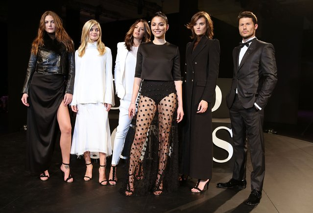 (L-R) Catherine McNeil, Megan Irwin, Camilla Freeman-Topper, Jessica Gomes, Marc Freeman, Montana Cox and Jesinta Campbell pose wearing designs by Camilla and Marc during rehearsal ahead of the David Jones Autumn/Winter 2016 Fashion Launch at David Jones Elizabeth Street Store on February 3, 2016 in Sydney, Australia. (Photo by Caroline McCredie/Getty Images for David Jones)