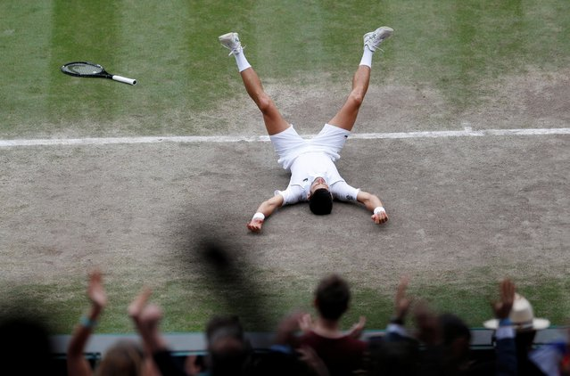 Serbia's Novak Djokovic celebrates winning against Italy's Matteo Berrettini during their men's singles final match on the thirteenth day of the 2021 Wimbledon Championships at The All England Tennis Club in Wimbledon, southwest London, on July 11, 2021. (Photo by Peter Nicholls/Pool via Reuters)
