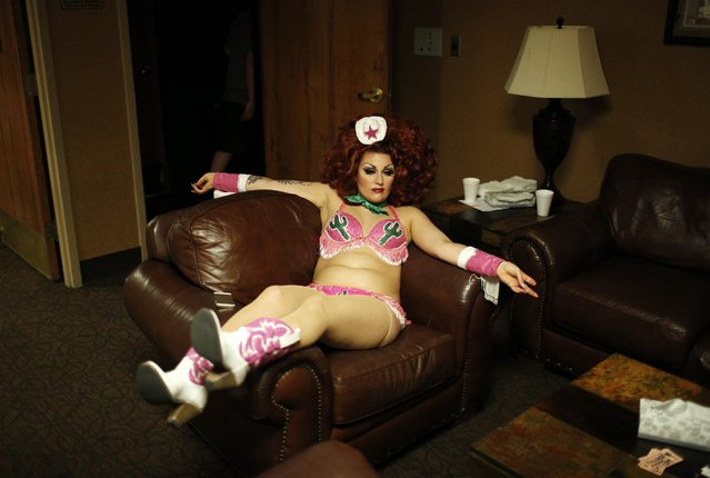 In this April 3, 2015, photo, Susanna Raphael Wellbourne of the burlesque duo Kitten and Lou rests backstage during a burlesque show at the Viva Las Vegas Rockabilly Weekend in Las Vegas. (Photo by John Locher/AP Photo)