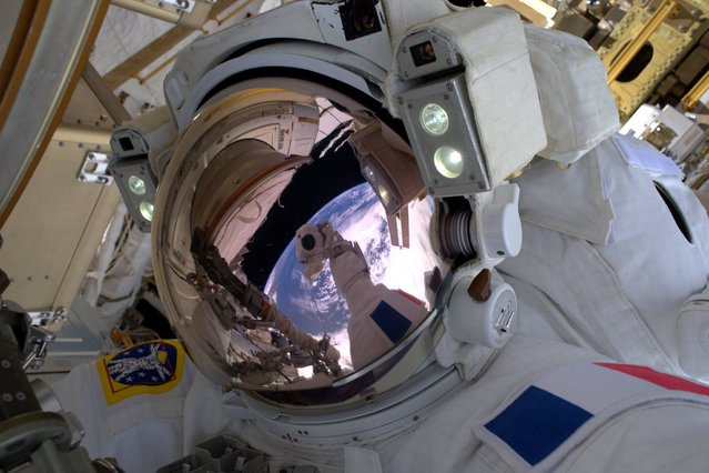 "This photo made by French astronaut Thomas Pesquet of the European Space Agency shows him in a selfie photograph with the Earth reflected in his visor, during a spacewalk outside the International Space Station on Friday, January 13, 2017. Pesquet, a rookie astronaut, became France's first spacewalker in 15 years. He called it ""a big day"". (Photo by Thomas Pesquet via AP Photo)"