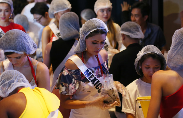 Miss Universe contestant Kristal Silva of Mexico helps pack meals for distribution to the needy in suburban Pasay city southeast of Manila, Philippines Wednesday, January 18, 2017. (Photo by Bullit Marquez/AP Photo)