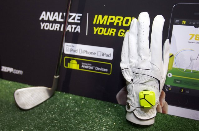 "A Zepp sensor is shown on a golf glove during ""CES Unveiled"", a media preview event to the annual Consumer Electronics Show (CES), in Las Vegas, Nevada, January 5, 2014. The sensors, available for golf, baseball and tennis, analyze 1,000 data points per second to create 3D representations of a player's swing, a representative said. The sensors retail for $149.99, he said. (Photoby Steve Marcus/Reuters)"