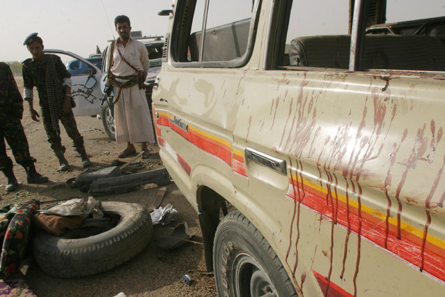 Viewed by Western analysts as the most dangerous arm of al Qaeda, AQAP claimed responsibility for the deadly January 2015 attack in Paris on the satirical French magazine Charlie Hebdo. Caption: Policemen stand by a tourist's car at the site of a suspected al-Qaeda car bomb attack in the Yemeni province of Marib July 3, 2007. (Photo by Khaled Abdullah/Reuters)