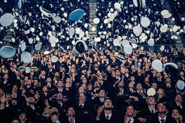 Newly-graduated police cadets attend a ceremony to take their oath of service in the Lanxess Arena on September 16, 2021 in Cologne, Germany. Approximately 2,750 cadets from both 2020 and 2019, who have been combined today due to the cancellation of the event last year because of the coronavirus pandemic, will be joining the state police force of North Rhine-Westphalia. (Photo by Lukas Schulze/Getty Images)