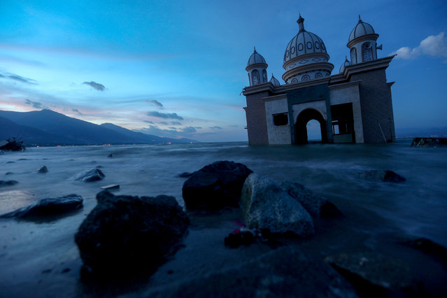 A remains of a mosque destroyed by the earthquake and tsunami is pictured in Palu, Central Sulawesi, Indonesia, October 5, 2018. (Photo by Athit Perawongmetha/Reuters)