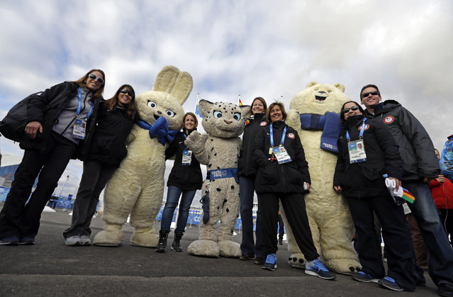 Members of the USA delegation pose for a picture with some mascots during a welcoming ceremony at the 2014 Winter Olympics, Thursday, February 6, 2014, in Sochi, Russia. (Photo by Morry Gash/AP Photo)