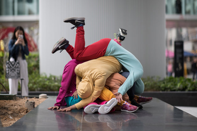 Dancers perform as human sculptures during an exhibition in Hong Kong, China, 26 March 2019. (Photo by Jerome Favre/EPA/EFE)