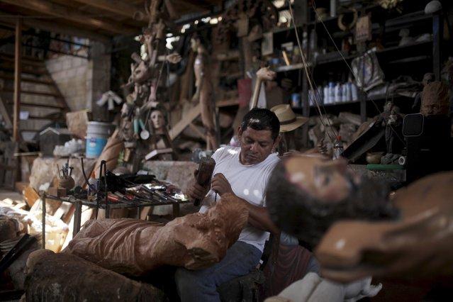 Jose Sabas Gomez works on a statue of El Jesus Nazareno in his workshop in Apastepeque, El Salvador March 9, 2016. (Photo by Jose Cabezas/Reuters)