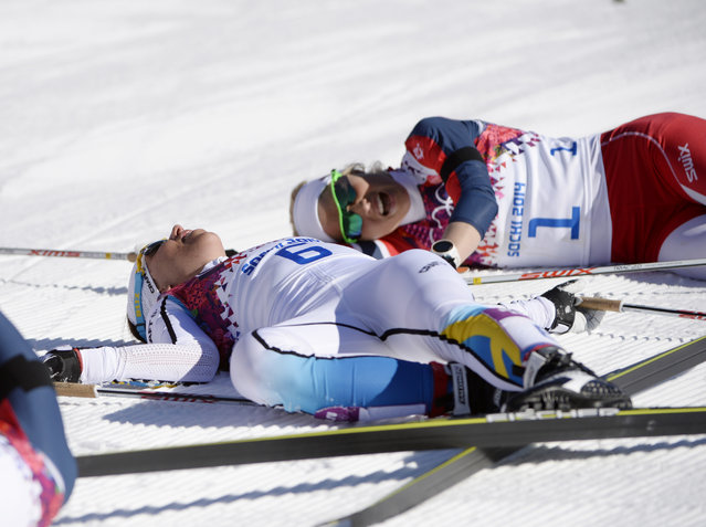 February 8, 2014; Krasnaya Polyana, Russia; Charlotte Kalla (SWE) and Therese Johaug (NOR) react at the finish line during the Sochi 2014 Olympic Winter Games at Laura Cross-Country Ski and Biathlon Center. (Photo by Eric Bolte/USA Today Sports)