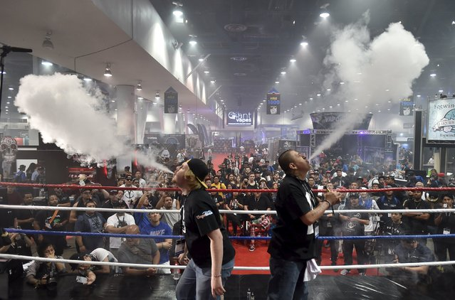 Attendees compete in the biggest vape cloud competition at the Vape Summit 3 in Las Vegas, Nevada May 2, 2015. (Photo by David Becker/Reuters)