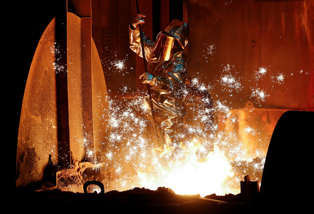 A steel worker of Germany's industrial conglomerate ThyssenKrupp AG which holds its annual shareholders meeting on Friday February 1, 2019, takes a sample of raw iron from a blast furnace at Germany's largest steel factory in Duisburg, Germany, January 28, 2019. (Photo by Wolfgang Rattay/Reuters)