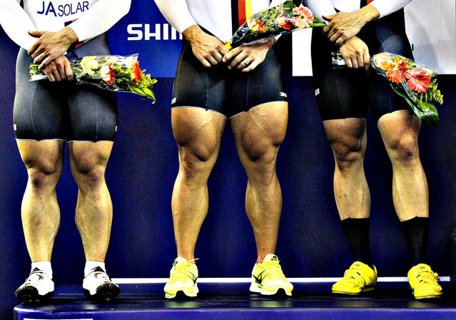 The legs of second placed German team, including Rene Enders, Robert Forstemann and Maximilian Levy are pictured during the ceremony in the men's team sprint race at the 2014 UCI Track Cycling World Championships in Cali February 26, 2014. (Photo by Jaime Saldarriaga/Reuters)