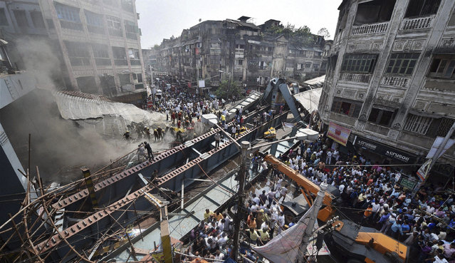 Locals and rescue workers clear the rubbles of a partially collapsed overpass in Kolkata, Thursday, March 31, 2016. (Photo by Swapan Mahapatra/Press Trust of India via AP Photo)