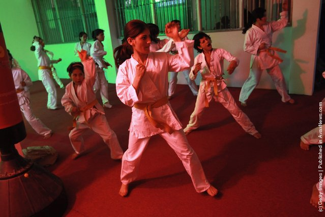 Afghan orphans practice during karate class at the Mehan Orphanage