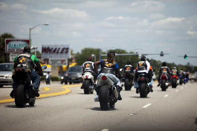 Bikers cruise down Kings Highway during the 2015 Atlantic Beach Memorial Day BikeFest in Myrtle Beach, South Carolina May 22, 2015. (Photo by Randall Hill/Reuters)