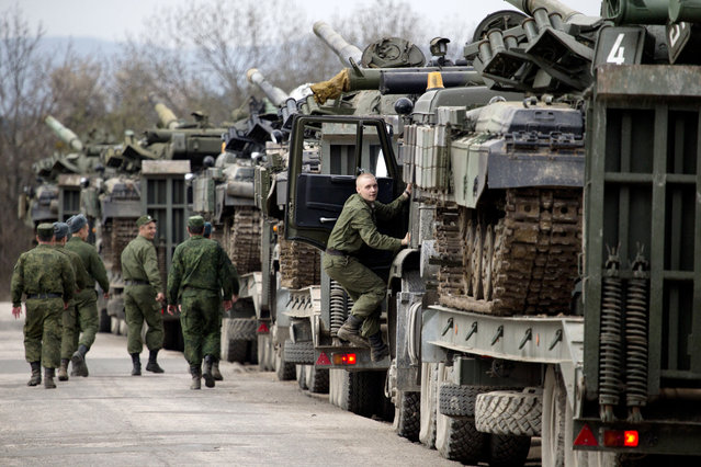 Ukrainian soldiers transport their tanks from their base in Perevalnoe, outside Simferopol, Crimea, Wednesday, March 26, 2014. Ukraine has started withdrawing its troops and weapons from Crimea, now controlled by Russia. Foreign policy used to stand out as a not-so-bleak spot in the public's waning assessment of Barack Obama.(Photo by AP Photo)