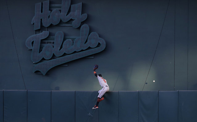 Baltimore Orioles center fielder Keon Broxton cannot catch a solo home run hit by Oakland Athletics' Beau Taylor during the third inning of a baseball game in Oakland, Calif., Tuesday, June 18, 2019. (Photo by Jeff Chiu/AP Photo)