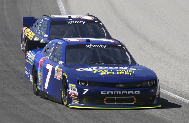 Regan Smith (7) drives past Chase Elliott (9) during the NASCAR Xfinity series auto race at Chicagoland Speedway, Sunday, June 21, 2015, in Joliet, Ill. (AP Photo/Nam Y. Huh)