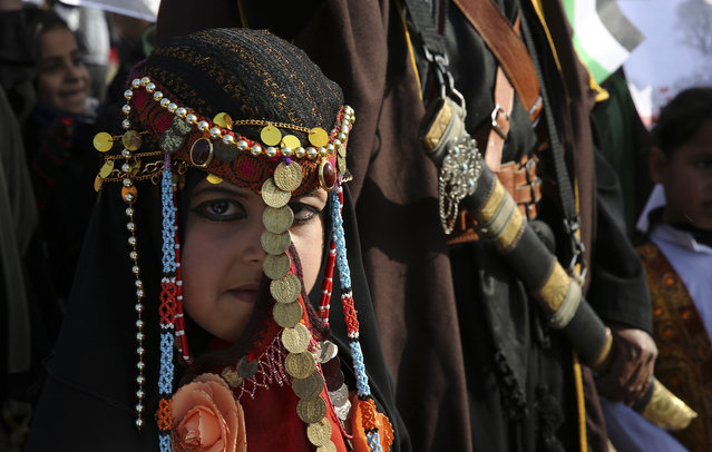 A bedouin girl wears traditional dress attend a rally marking the 41st anniversary of Land Day, in Deir el-Balah, Central Gaza Strip, Friday, March 31, 2017. Land Day commemorates riots on March 30, 1976, when many were killed during a protest by Israeli Arabs whose property was annexed in northern Israel to expand Jewish communities. (Photo by Adel Hana/AP Photo)