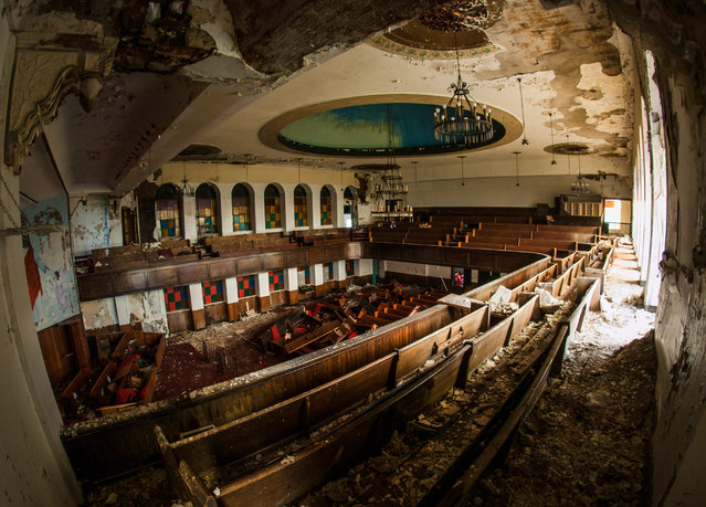 Smashed pews inside the Tried Stone Baptist church of Detroit, Michigan. (Photo by Jonny Joo/Barcroft Media)