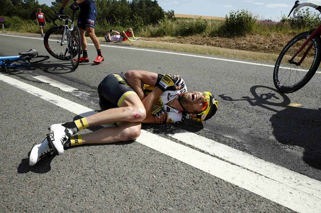 Lotto-Jumbo rider Laurens ten Dam of the Netherlands lies on the ground after a fall during the 159,5 km (99 miles) third stage of the 102nd Tour de France cycling race from Anvers to Huy, Belgium, July 6, 2015. (Photo by Benoit Tessier/Reuters)