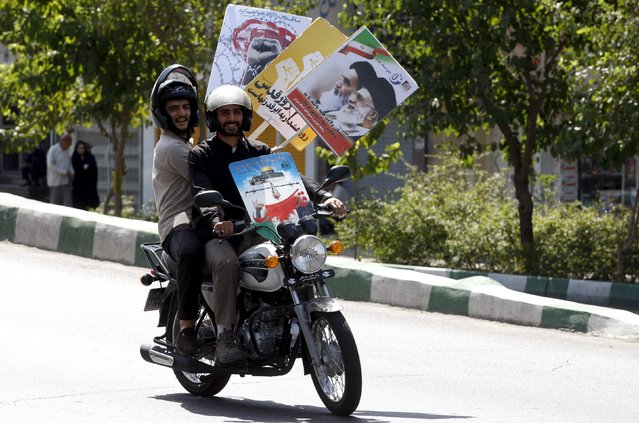 A motorcyclist carries a poster depicting Iran's Supreme Leader Ayatollah Ali Khamenei and Iran's late leader Ayatollah Khomeini during a rally marking al-Quds (Jerusalem) Day in Tehran July 10, 2015. (Photo by Reuters/Stringer/TIMA)
