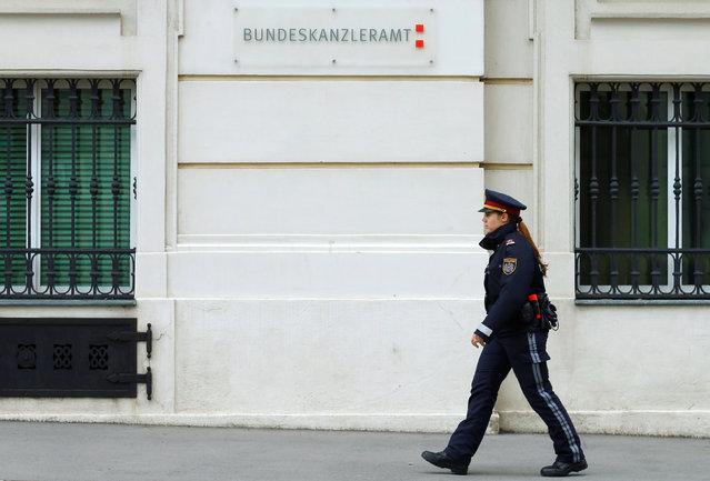 A police officer walks in front of the Austrian chancellery (Bundeskanzleramt) in Vienna, Austria, May 13, 2016. (Photo by Heinz-Peter Bader/Reuters)