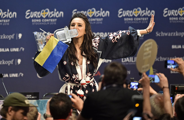Jamala of Ukraine kisses the trophy at the press conference after winning the Eurovision Song Contest final in Stockholm, Sweden, early Sunday, May 15, 2016. (AP Photo/Martin Meissner)