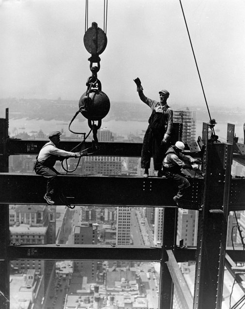 The picture shows members of a derrick gang fixing a beam during the construction of the Empire State Building, showing the streets of New York far below them, 1931. Lewis Wickes Hine (1874-1940) used photography as a documentary tool to inspire social reform: his subjects included child labour, the immigrants of Ellis Island and construction workers in industry, railways and building. They reveal both the horror of exploitation and the dignity of work. (Photo by SSPL/Getty Images)