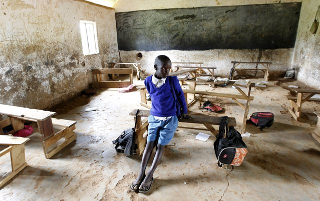Seven-year-old Barack Obama Okoth, named after U.S. President Barack Obama, sits inside an empty classroom as he speaks with Reuters at the Senator Obama primary school in Nyangoma village in Kogelo, west of Kenya's capital Nairobi, June 23, 2015. When Barack Obama visits Africa this month, he will be welcomed by a continent that had expected closer attention from a man they claim as their son, a sentiment felt acutely in the Kenyan village where the 44th U.S. president's father is buried. (Photo by Thomas Mukoya/Reuters)