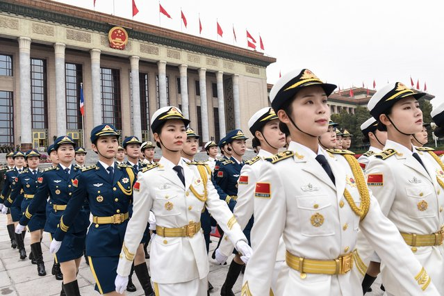 Military honour guards prepare for a welcome ceremony with French President Emmanuel Macron and Chinese President Xi Jinping at the Great Hall of the People in Beijing on November 6, 2019. (Photo by Nicolas Asfouri/AFP Photo)